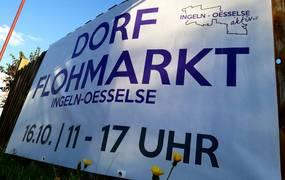 Weißes Banner mit Informationen zum Flohmarkt ©Ingeln Oesselse Aktiv e.V.