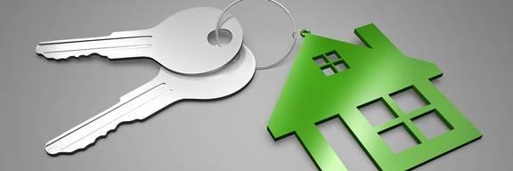 Grünes Haus mit einem Schlüssel